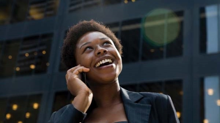 Woman smiling while talking on phone