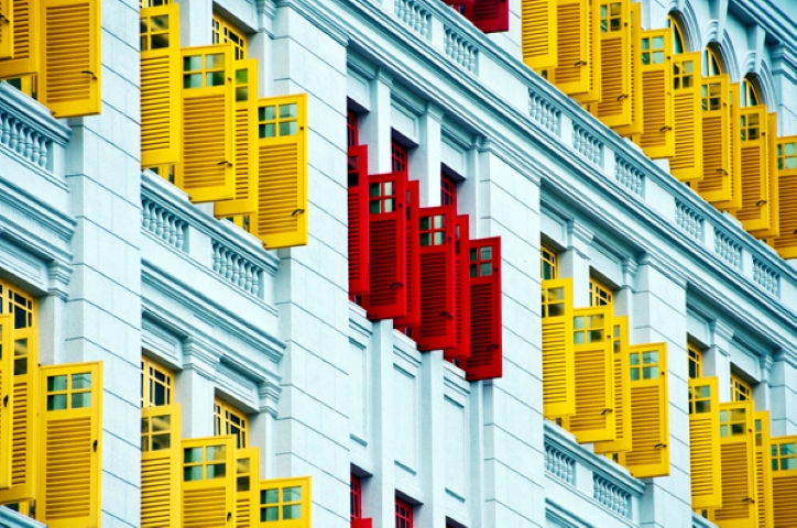 Red shutters surrounded by yellow