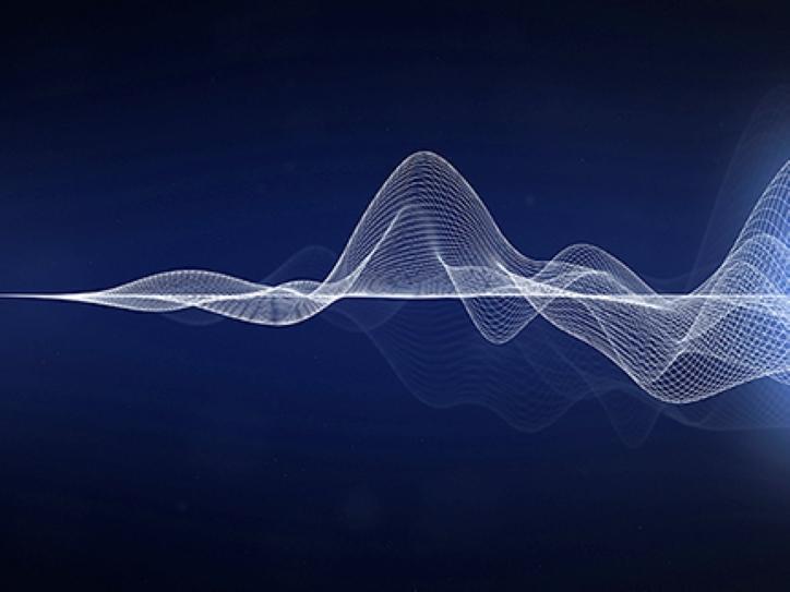 White soundwaves on dark background