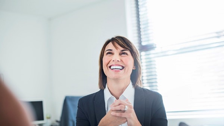 Woman smiling in sunny office