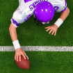 Football player scoring a touchdown before hitting the floor