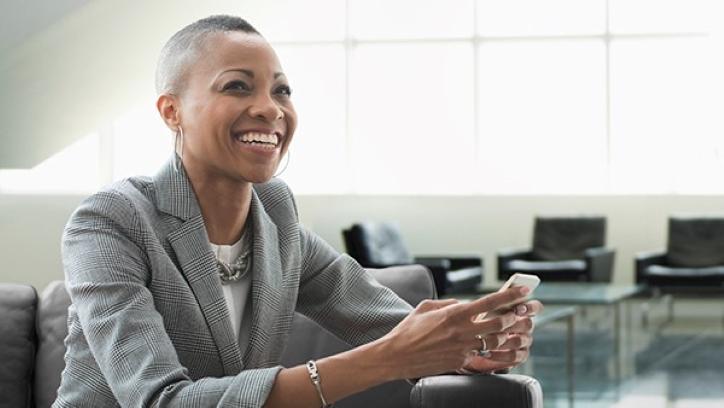 Smiling businesswoman on sofa