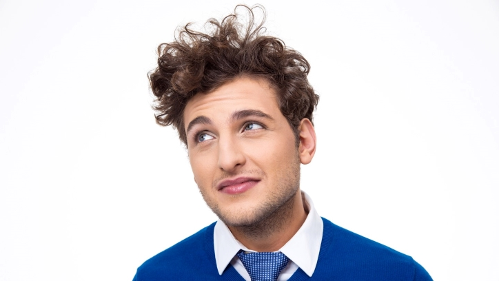 Curly-haired man looking up