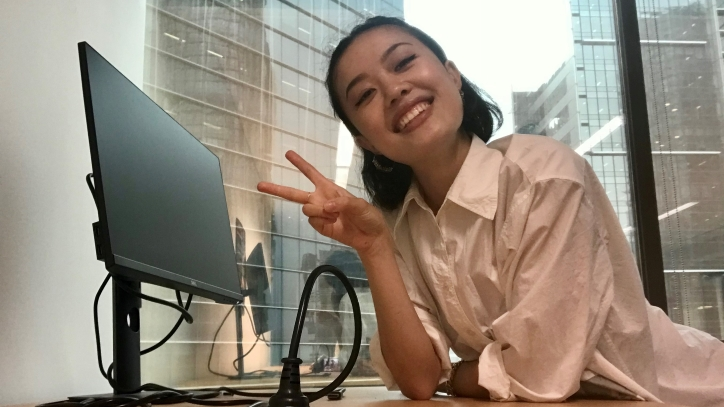 Lina Lau sitting at work computer