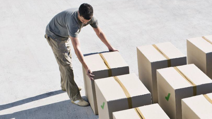 Supply chain: Man moving boxes