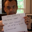 Tristan Morel L'horset holding up Reddit invitation sign