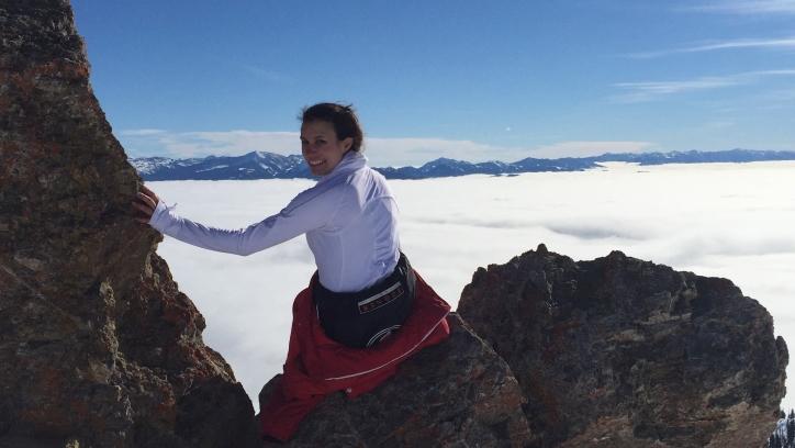Caroline Larose sitting on mountain