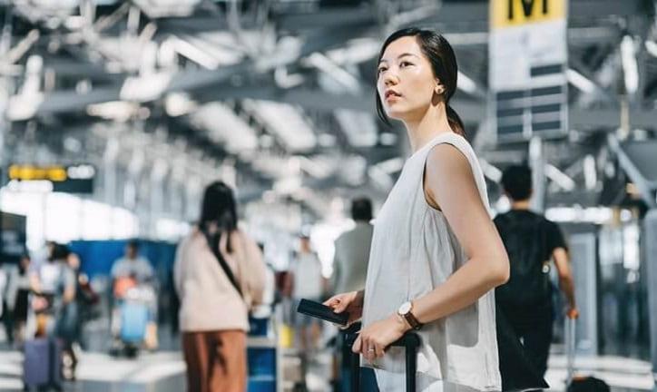 Woman on train station platform.